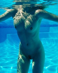 Sophia loves to feel the cool water on her nude curves
