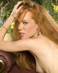 Fiery redhead Heather Carolyn strips off her bar and panties revealing her sexy petite body.
