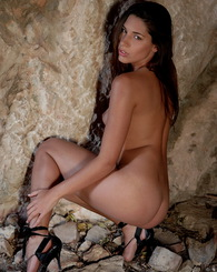 Nice looking babe Adriana showing of her perfect naked body in caves